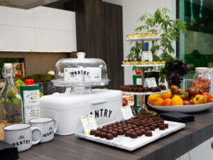 A Los Angeles cannabis open house featured edibles, vape pens, and cannabis decor.